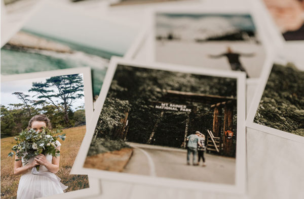 Printed wedding photos with white canvas are laid on the table that were made by wedding photographer in Amsterdam
