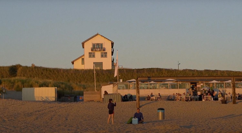 The shot from movie of videograaf Nederland that shows landscape of coastline in Netherlands near dunes at Scheveningen.