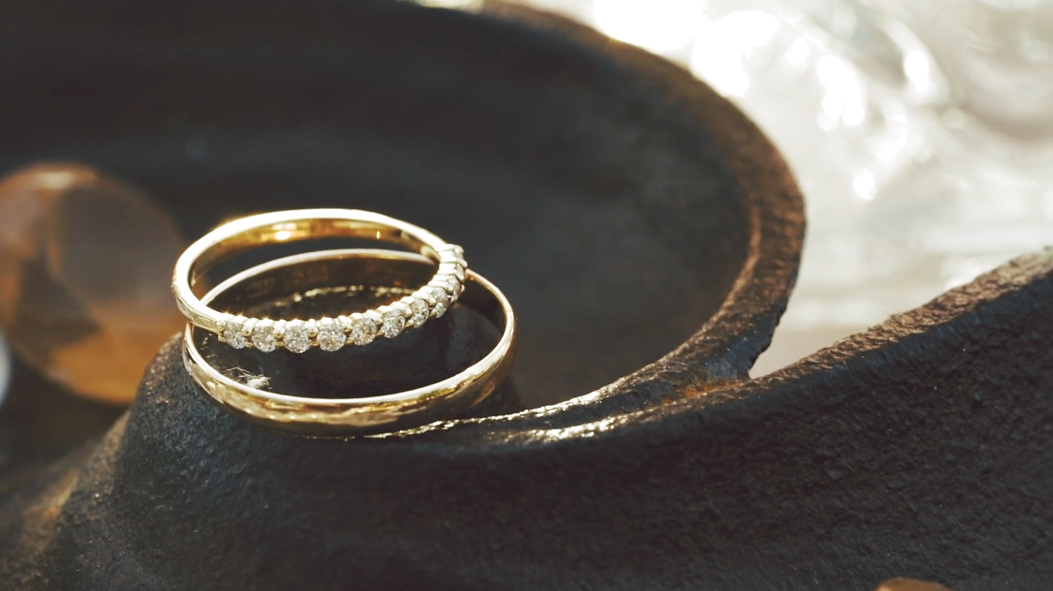 wedding rings are on the old metal surface, captured by photographer in Amsterdam