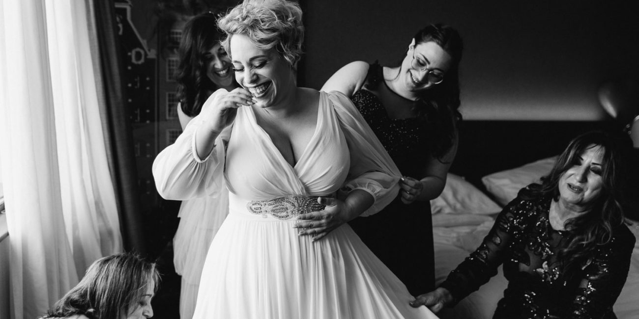 pluse size bride is getting ready with bridesmaids шт the hotel
